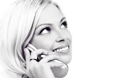 Woman and cellular phone. Smiling young woman calling by  cellular phone Royalty Free Stock Photo