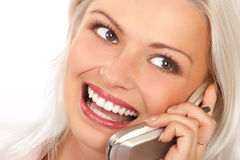 Woman and cellular phone. Smiling young woman calling by  cellular phone Royalty Free Stock Photography