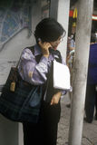 Woman on cellular phone in Hong Kong stock photography