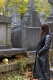 Woman in cemetery Stock Photography