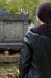 Woman in cemetery Royalty Free Stock Image