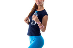 Woman with centimeter holding a bottle of water Stock Photography