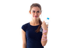Woman with centimeter holding a bottle of water Royalty Free Stock Image