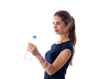 Woman with centimeter holding a bottle of water Royalty Free Stock Images