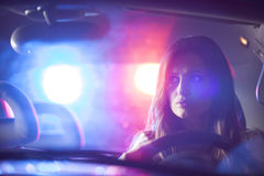 Woman chaced by police Stock Photography