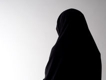 Woman in chador from behind, with copyspace Stock Photos