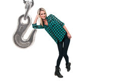 Woman and Chain Hook. Beautiful woman and an industrial chain and hook Royalty Free Stock Photography