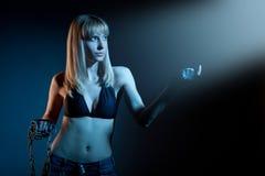 Woman with chain studio shot Stock Photo