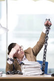 The woman chained to her working desk Royalty Free Stock Image