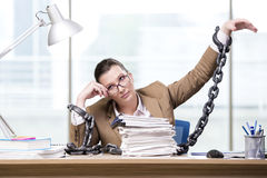 The woman chained to her working desk Stock Photography