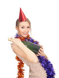 Woman in chains and cone hat with champagne Stock Photos