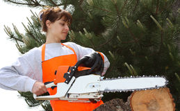 A woman with a chainsaw Royalty Free Stock Images