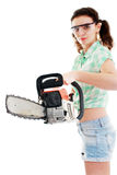 Woman with chainsaw. Young woman with motorsaw on a white background, focus is on chainsaw woman is out of focus stock photo