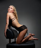 Woman on chair Stock Images