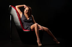 Woman in the chair Stock Photography