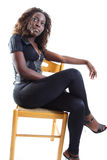 Woman on a Chair Stock Images