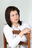 Woman on a chair Stock Photos