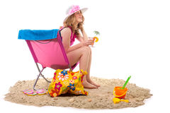 Woman in chair at the beach Stock Image