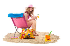 Woman in chair at the beach Stock Photos