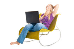 Woman on chair with laptop Royalty Free Stock Photo