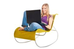 Woman on chair with laptop Royalty Free Stock Photography