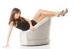 Woman in chair with legs raised Stock Images