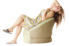 Woman in chair looks up Royalty Free Stock Photography