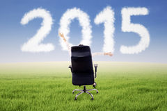 Woman on chair with number 2015 Royalty Free Stock Photos