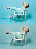 Woman on a chair in pin-up style. Stock Photo