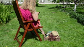 Woman chair read book stock footage