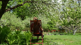 Woman chair relax garden Royalty Free Stock Image