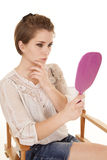 Woman chair touch face pink mirror Royalty Free Stock Images