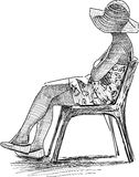 Woman on a chair Royalty Free Stock Image