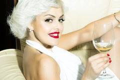 Woman in chair with wine Royalty Free Stock Photos
