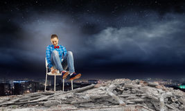 Woman in chair. Young woman sitting in chair on ruins Royalty Free Stock Photography