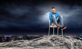 Woman in chair. Young woman sitting in chair on ruins Royalty Free Stock Photos