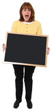 Woman with Chalkboard. Attractive 57 year old teacher with blank chalkboard over white Royalty Free Stock Photography