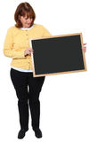 Woman with Chalkboard. Attractive 57 year old teacher with blank chalkboard over white Stock Photography