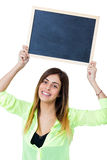 Woman with chalkboard Stock Images