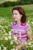 Woman in chamomile Stock Image