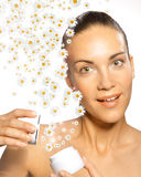 Woman with chamomile cream Stock Photography