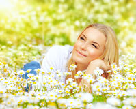 Woman in chamomile meadow Royalty Free Stock Photo