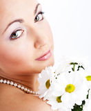 Woman with chamomiles Royalty Free Stock Image