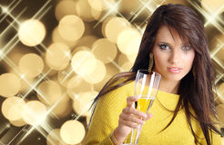Woman with champagne. Sexy happy woman with champagne over blur light background Royalty Free Stock Photo