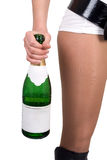 Woman with a champagne bottle Stock Images
