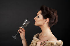 Woman with champagne flute Royalty Free Stock Images