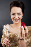 Woman with champagne flute and strawberry Stock Image