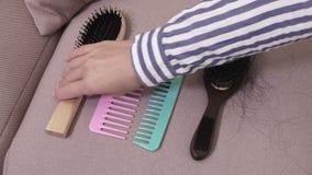 Woman change combs. In room stock video