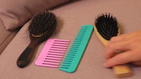 Woman change combs on sofa. In room stock video footage