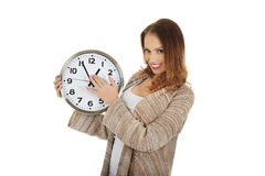 Woman changes clock leads. Royalty Free Stock Photo